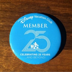 blue pin disney vacation club 25th anniversary collectable wood grain background